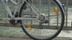 Bike leaning on a balustrade on the Donaukanal, Vienna Stock Footage