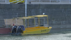 Yellow boat anchored on the Danube river, Vienna Stock Footage