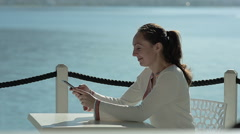 Young Girl Writes SMS on Vacation Stock Footage