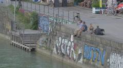 People sitting on the Donaukanal, Vienna Stock Footage