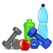Dumbbells with apple and protein shaker Stock Photos
