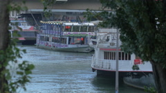 Tourist boats anchored on Danube river, Vienna Stock Footage