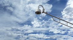 Surveillance Camera Against Timelapse Clouds Stock Footage