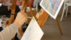 Female artist paints picture artwork in art studio Stock Footage