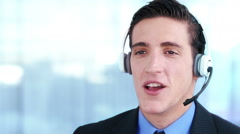 Customer support operator. Telemarketer. Young man working in a callcenter. Stock Footage