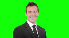 Young and attractive businessman smiling at the camera. Chroma key. Success. Stock Footage