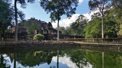 Water reflection Angkor Thom Cambodia ancient stone ruin temple - stock footage