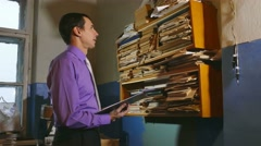 Accounting clerk man retro touches the paper in an old office - stock footage