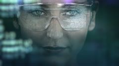 Stock Video Footage of Young woman with holographic glasses. Futuristic. Augmented reality. Dark.