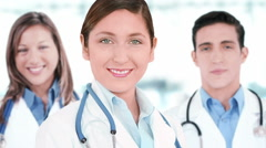 Doctors smiling and looking at the camera. Hospital background. Teamwork. Stock Footage