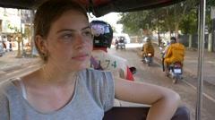 Backpacker tourist girl traveling in asia riding on tuk tuk rural asain villag Stock Footage