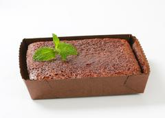 Brownie cake in paper food tray - stock photo