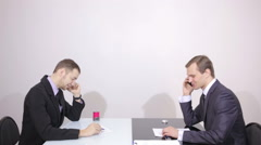 Two businessmen talking on the phone. office staff work. successful negotiations Stock Footage