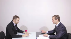 Businessman makes a proposal and the partner was refused. two men at the table Stock Footage