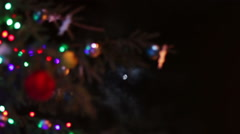 Christmas tree decorated with toys and lights at night on a background of the - stock footage