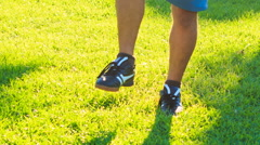Man Does Morning Exercises Circles Feet on Grass Lawn - stock footage
