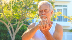 Old Man Does Morning Exercises Stretches Fingers in Park Stock Footage