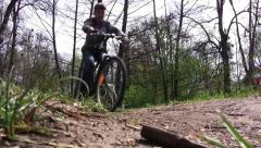 Guy who walks through the park with his bike Stock Footage