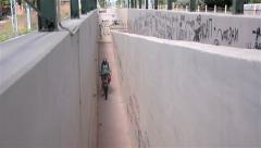 Man cycling down the aisle to pass on the other side of the railway 6 Stock Footage
