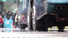 Man pressure washing hose, tourist bus was parked in a station 1 (1) Stock Footage