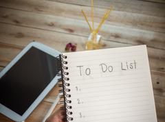 To do list notebook with tablet calculator pencil on wood floor , digital eff Stock Photos