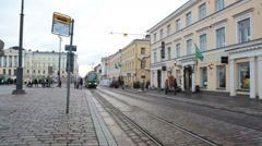 Stock Video Footage of Green streetcar route number 4 drives on Senate Square on pavement, Helsinki