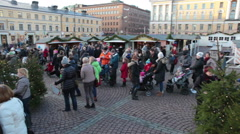 Long queue at merry-go-round is at Christmas market, Helsinki - stock footage
