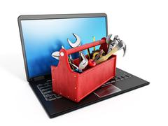 Red toolbox standing on laptop computer - stock illustration