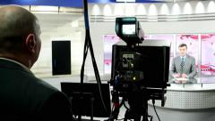 Backstage news channel - operator takes the performer man in the news studio Stock Footage