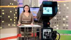 Creating the evening news in the studio, woman performer reads the news Stock Footage