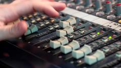 Fingers move the fader sliders sound mixer close-up Stock Footage