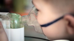 The little boy makes treatment procedure by an inhaler where upper respiratory t - stock footage