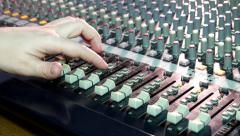 Radio Fingers move the fader sliders on the big sound mixer in the recording - stock footage