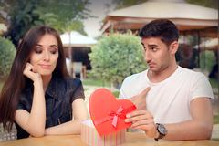 Girl Disappointed on Her Valentine Gift From Boyfriend - stock photo