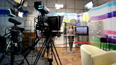 Production of news in studio backstage girl reading a news feed rear view Stock Footage