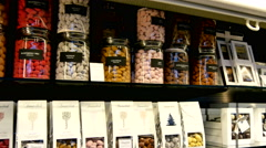 Shopping chocolate in the Market Halls, with  all sorts of luxury products - stock footage