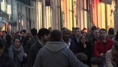Lisbon Portugal Crowds of People walking through city centre in Winter Stock Footage
