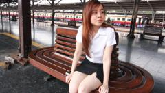 Thai student university beautiful girl relax and smile, Leisure travel by rail Stock Footage