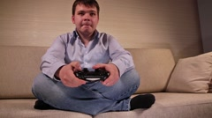 Playing Videogames with Gamepad - stock footage