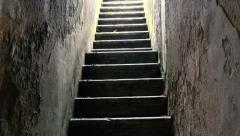 Atmospheric Stone Stairwell _  upwards camera tilt - stock footage