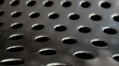 Clean Perforated Metal with Blinking Reflections v2 Stock Footage