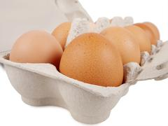 Ten fresh eggs Stock Photos