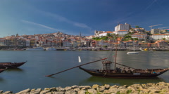 Porto, Portugal old town skyline on the Douro River with rabelo boats timelapse Stock Footage