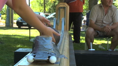Children balancing bowling ball game Stock Footage