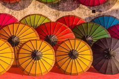 Umbrella at a tropical market, Luang Prabang in Laos - stock photo