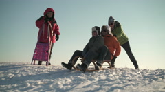 happy senior men sledging down snowy hill - stock footage