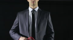 Man in a business suit holding a whip for sex games. red skin. love toys Stock Footage