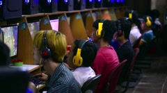 Young gamers play video games at one of city computer game clubs Stock Footage