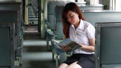 Thai adult beautiful girl read a book, Leisure travel by rail Stock Footage