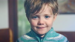 Little baby looking confused, tired, smile with mouth closed Stock Footage